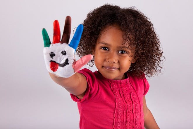 child with painted hand