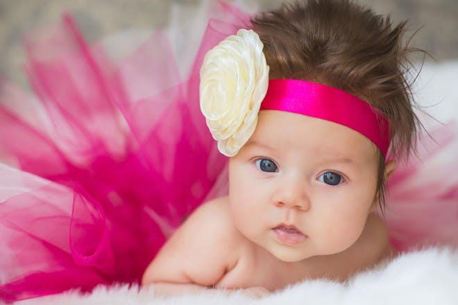 Baby wearing a pink headband and tutu