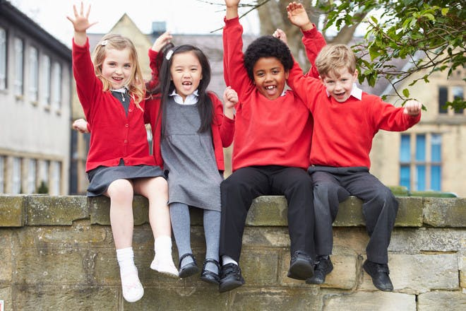 Primary school kids cheering together