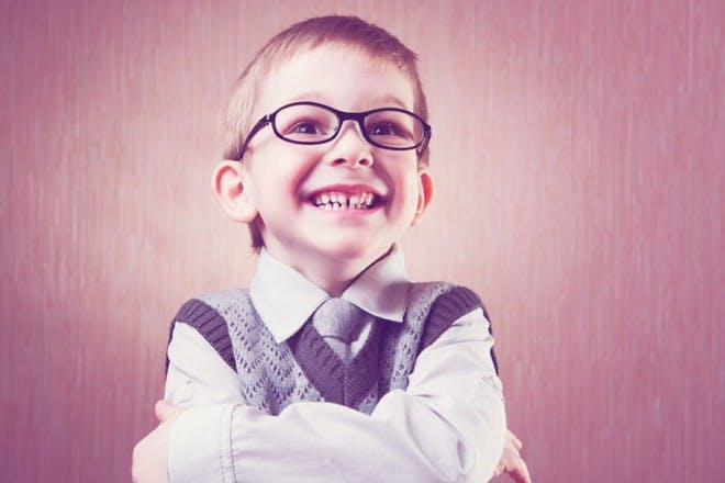 boy smiling with arms folded