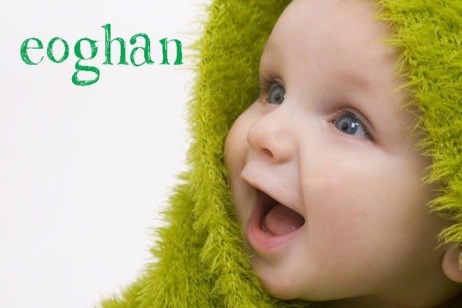 baby under green blanket