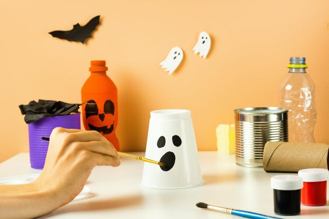 Cup painted as a ghost for Halloween craft