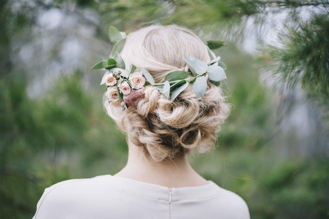 6. Messy floral cross braids