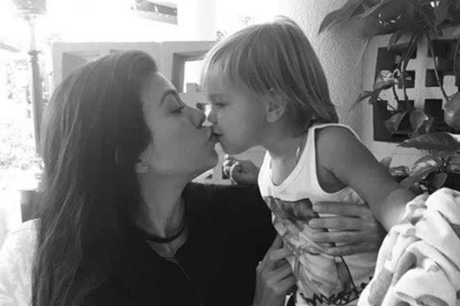 Kourtney Kardashian kissing Reign