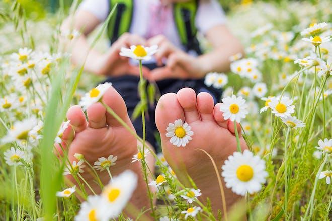 Girl sitting in daisy field