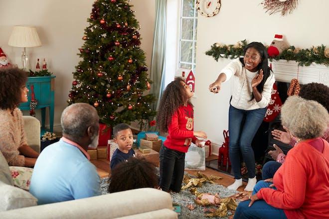 A family playing Christmas charades