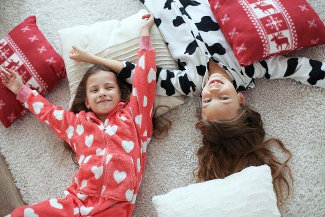 Kids in pjs on floor