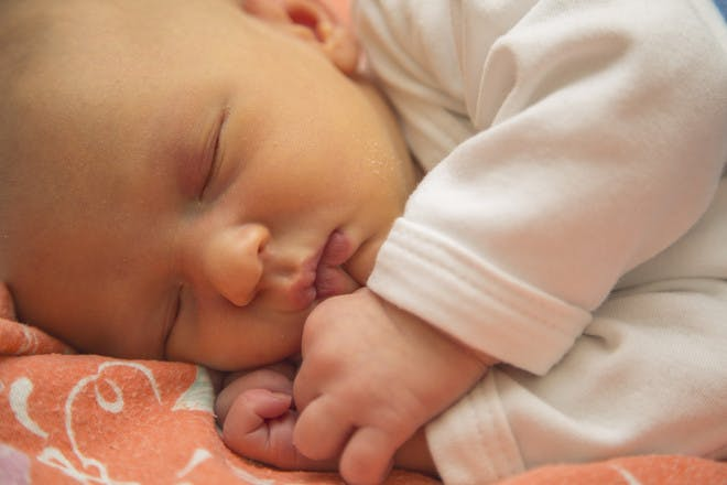 sleeping newborn with jaundice