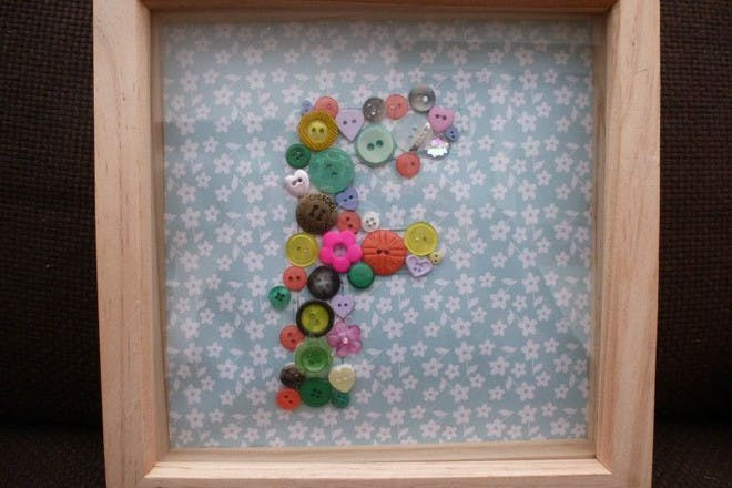 framed letter made from buttons
