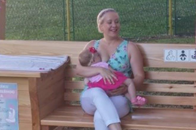 Woman breastfeeding on bench