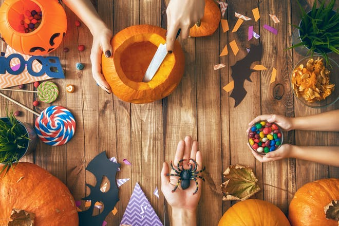 Table of Halloween treats, pumpkins and crafts
