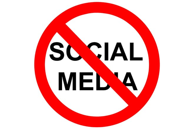 A red sign with social media crossed out in the middle