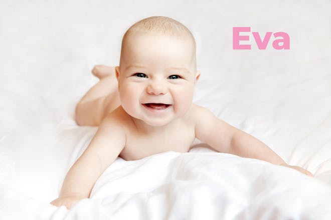 Smiling baby on bed. Name Eva written in text