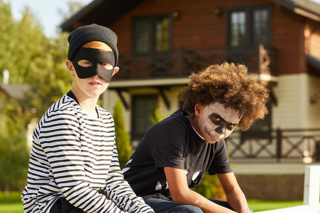 Two little boys dressed as a burglar and a skeleton