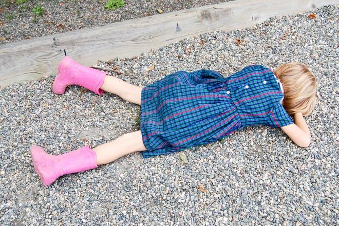 little girl face down on floor