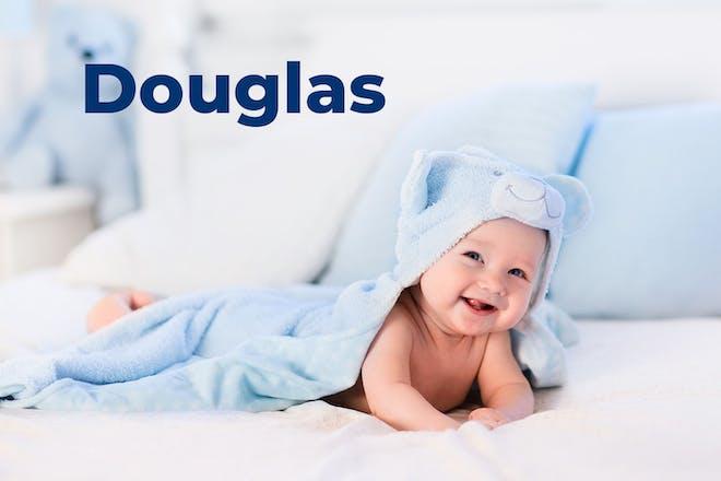 Baby wearing blue hooded towel. Name Douglas written in text
