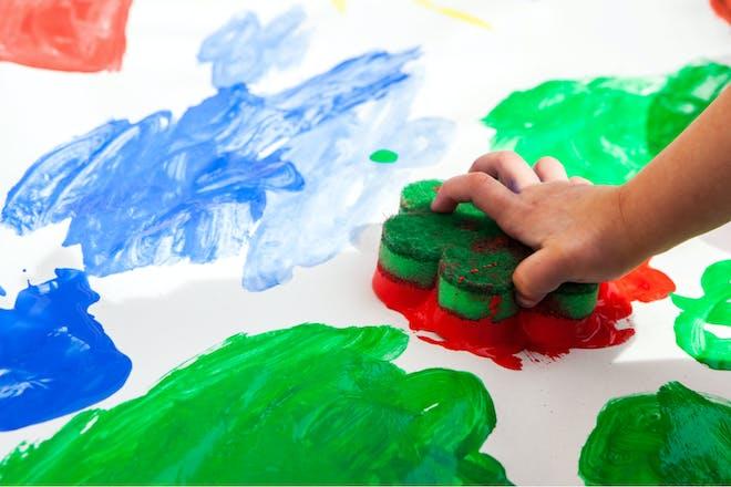 child doing sponge painting