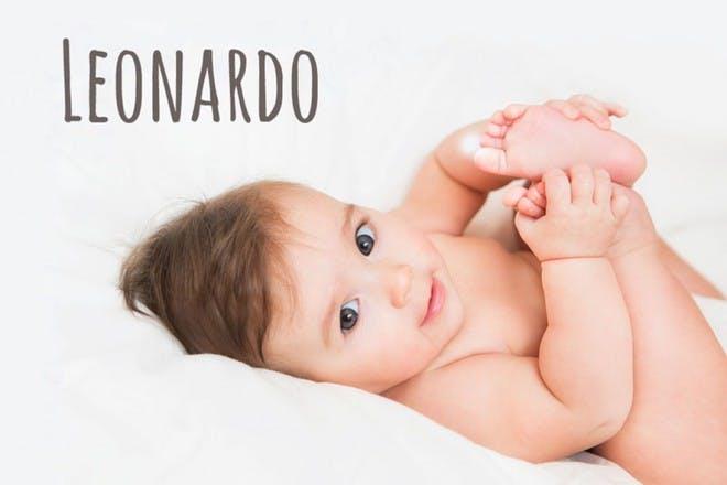 baby holding feet
