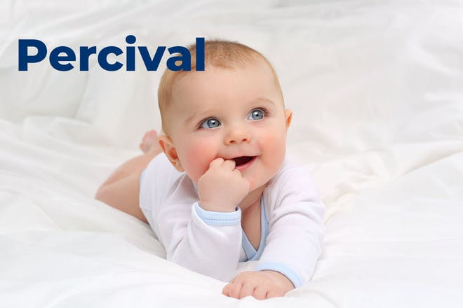 Baby lying on front with head up, hand in mouth. Name Percival written in text