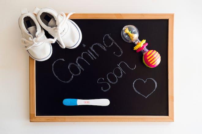 Chalk board pregnancy announcement