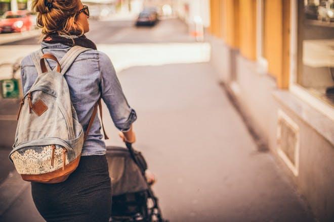 Woman pushing pram