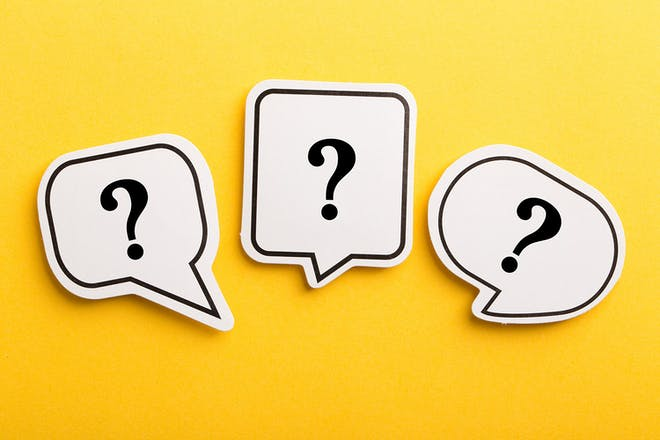 3 question marks in speech bubbles on yellow background