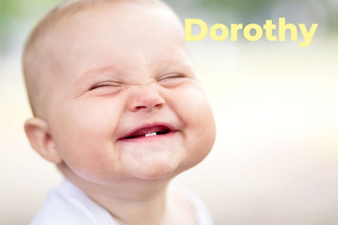 Baby's grinning face. Name Dorothy written in text