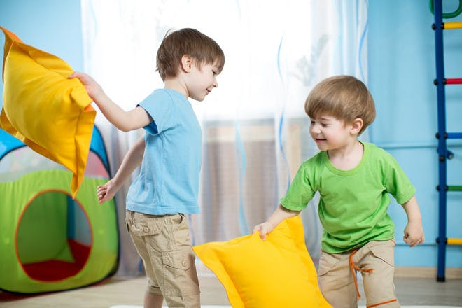 Kids pillow fighting at soft play