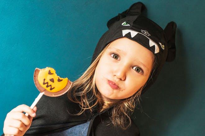 Little girl dressed as a bat