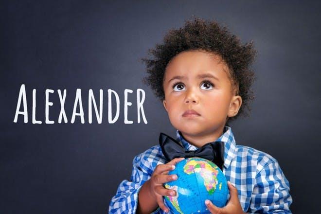 child holding world globe