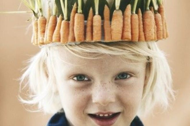 little boy in hat made from carrots