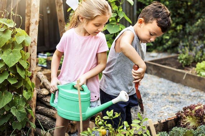 Boy and girl gardening