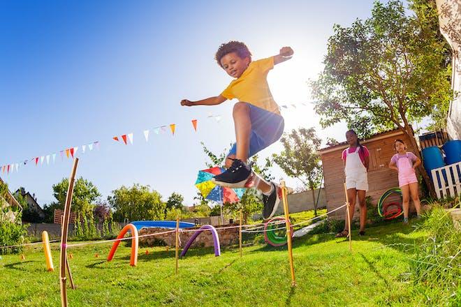 boy junmping over homemade hurdles