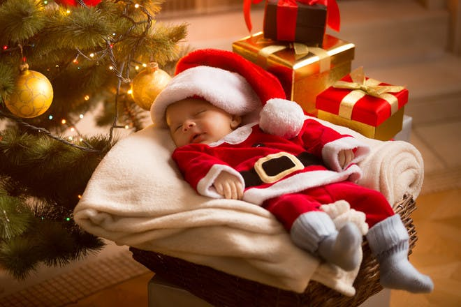 Baby sleeping in Santa suit