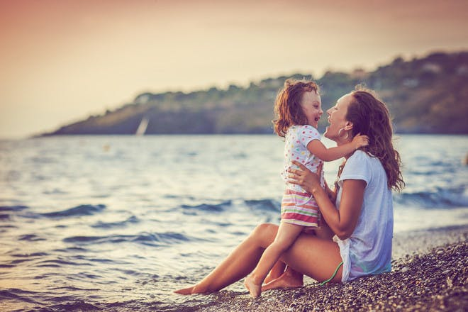 Mum with daughter at beach