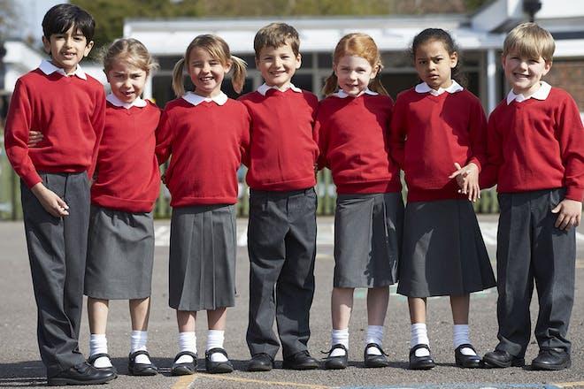 Group of primary school children standing together in uniform