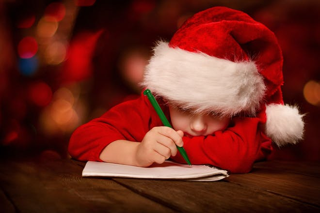 A kid writing a letter to Santa