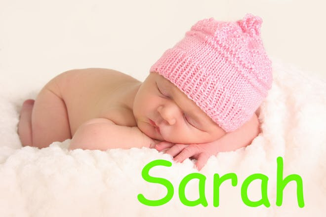 Baby girl sleeping with the name Sarah in text