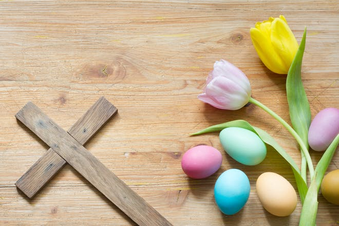 Easter eggs and flowers with cross