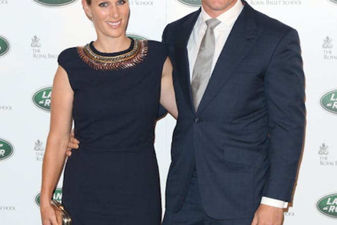 Woman in black dress and man in blue suit