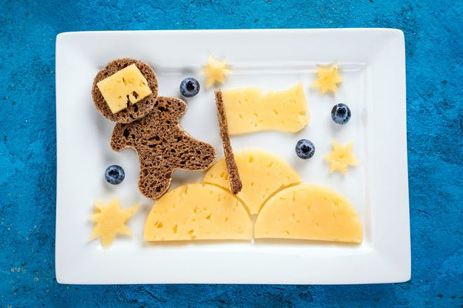 Astronaut made from bread and planet and stars made from cheese