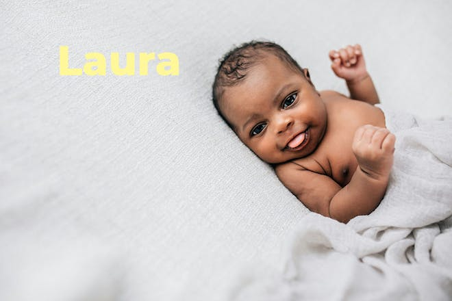 baby sticking tongue out. Name Laura written in text