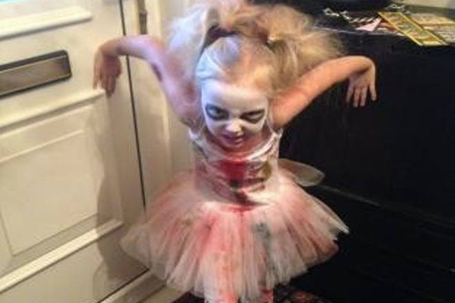 A girl dressed as a zombie ballerina