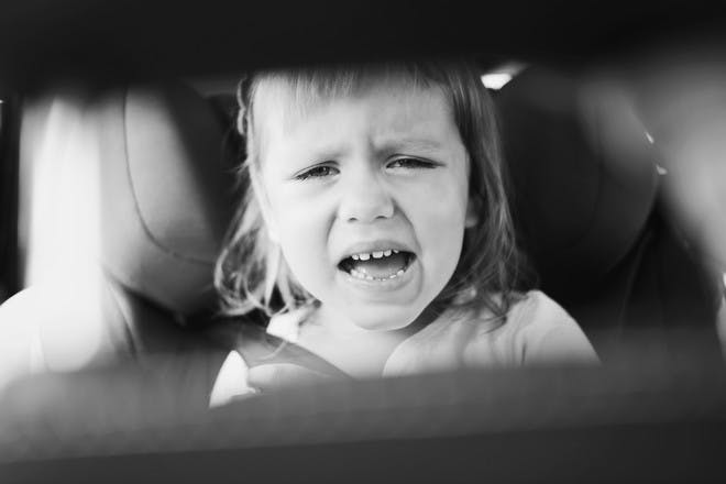 Child with car sickness