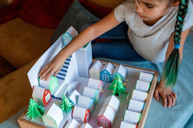 Child playing with a homemade advent calendar
