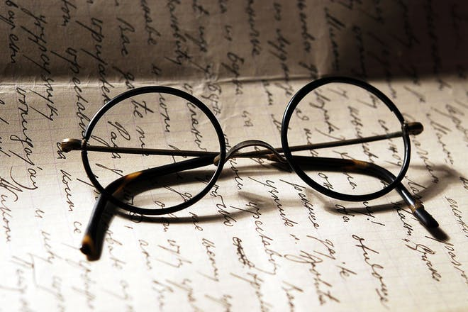 Harry Potter glasses on page of writing