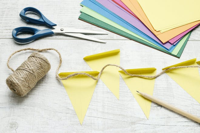 Paper bunting with scissors, card, string and pencil