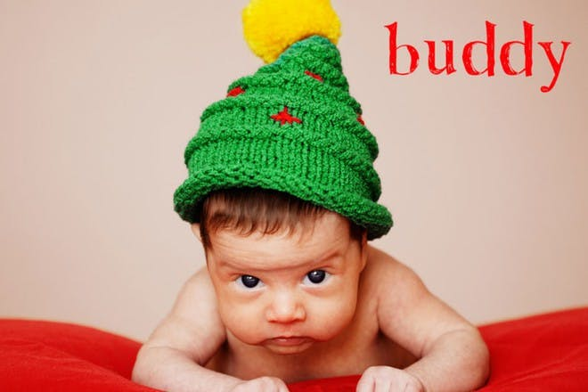 baby in christmas tree hat