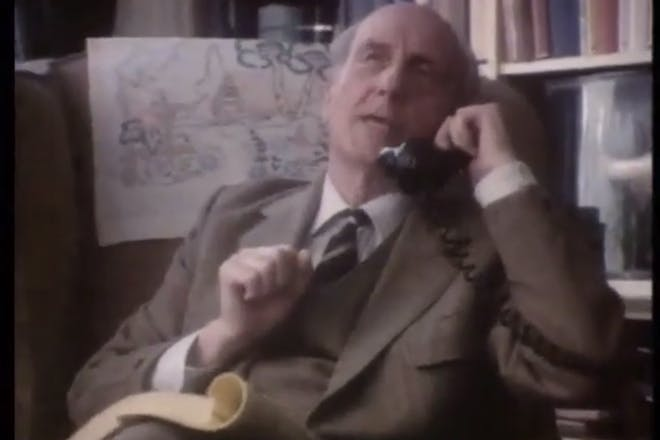 Old man talks on phone in vintage Yellow Pages advert