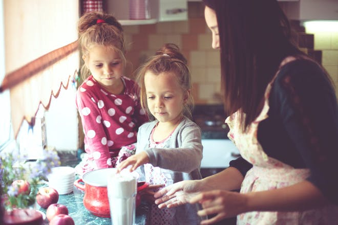 mum cooking with kids in kitchen
